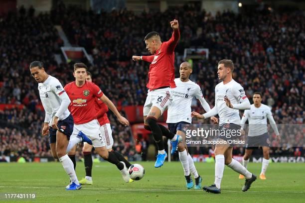 Marcos Rojo of Man Utd in action with teammate Harry Maguire of Man Utd as well as Virgil van Dijk of Liverpool Fabinho of Liverpool and Jordan...