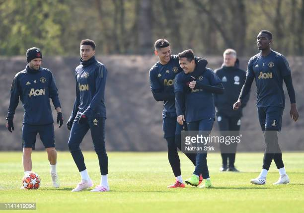 Marcos Rojo of Manchester United and Alexis Sanchez of Manchester United share a joke during the Manchester United training session ahead of the UEFA...