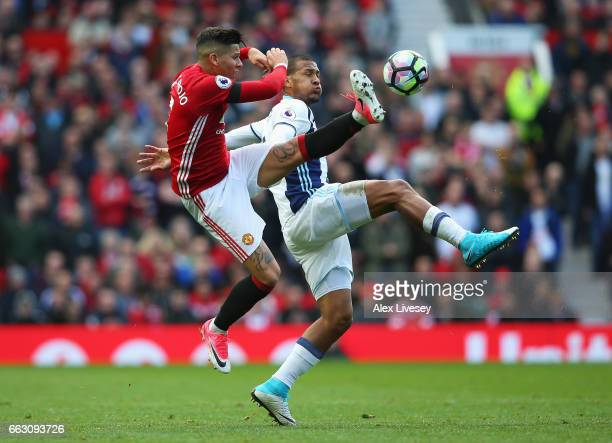 Marcos Rojo of Manchester United and Jose Salomon Rondon of West Bromwich Albion battle for possession during the Premier League match between...