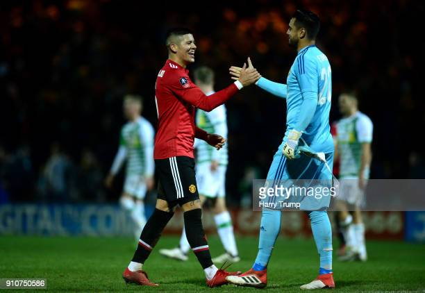 Marcos Rojo of Manchester United and Sergio Romero of Manchester United celebrate after The Emirates FA Cup Fourth Round match between Yeovil Town...