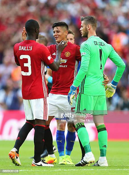 Marcos Rojo of Manchester United and team mate Eric Bailly of Manchester United embrace after the final whistle during The FA Community Shield match...