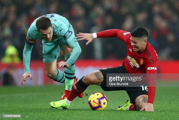 Marcos Rojo of Manchester United battles for possession with Aaron Ramsey of Arsenal during the Premier League match between Manchester United and...