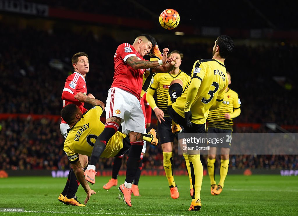 Marcos Rojo of Manchester United battles with Troy Deeney and Miguel Angel Britos of Watford during the Barclays Premier League match between Manchester United and Watford at Old Trafford on March 2, 2016 in Manchester, England.