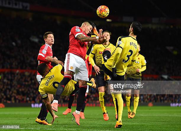 Marcos Rojo of Manchester United battles with Troy Deeney and Miguel Angel Britos of Watford during the Barclays Premier League match between...