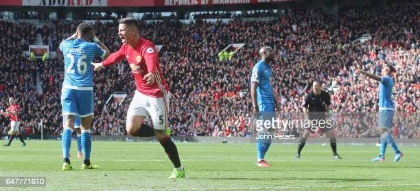 Marcos Rojo of Manchester United celebrates scoring their first goal during the Premier League match between Manchester United and AFC Bournemouth at...
