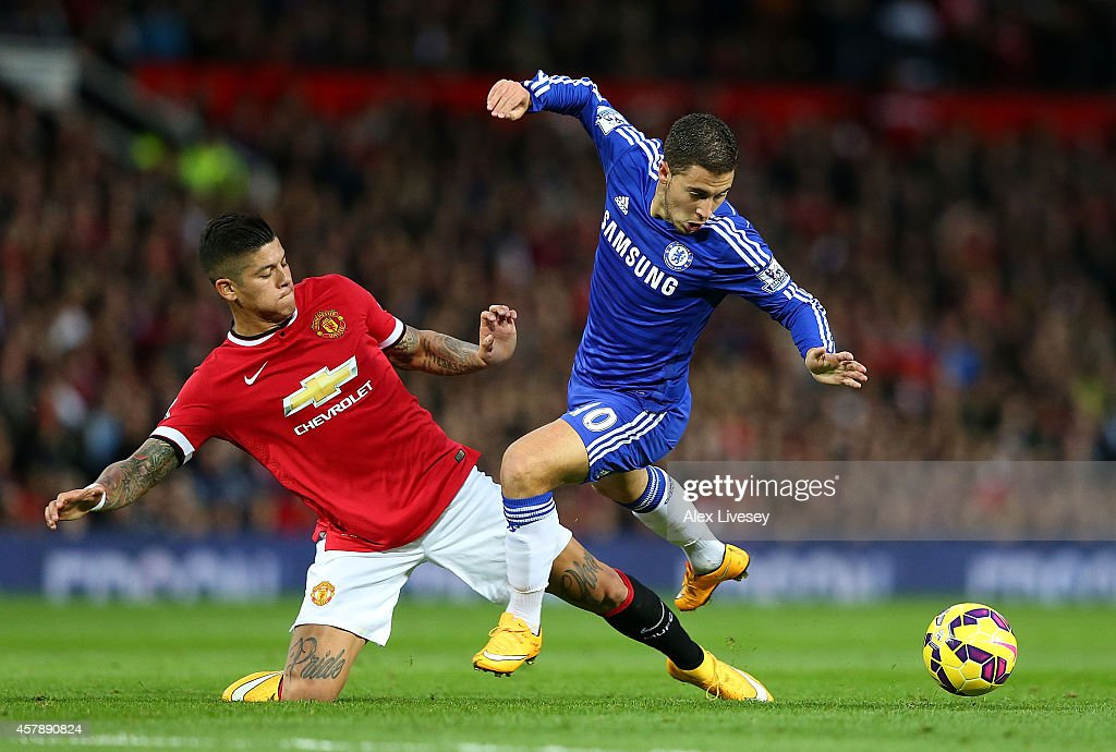 Marcos Rojo of Manchester United challenges Eden Hazard of Chelsea during the Barclays Premier League match between Manchester United and Chelsea at Old Trafford on October 26, 2014 in Manchester, England.