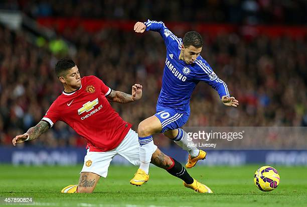 Marcos Rojo of Manchester United challenges Eden Hazard of Chelsea during the Barclays Premier League match between Manchester United and Chelsea at...