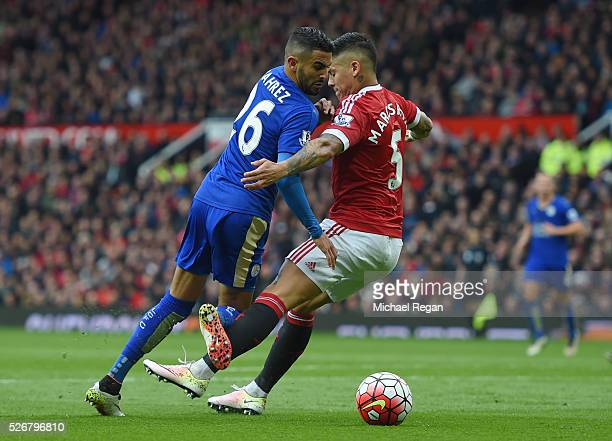Marcos Rojo of Manchester United challenges Riyad Mahrez of Leicester City in the penalty area during the Barclays Premier League match between...