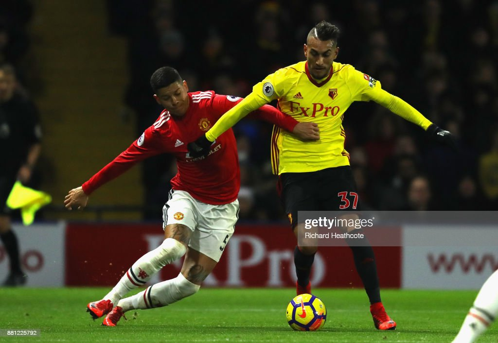 Marcos Rojo of Manchester United challenges Roberto Pereyra of Watford on his way to conceding a penalty during the Premier League match between Watford and Manchester United at Vicarage Road on November 28, 2017 in Watford, England.