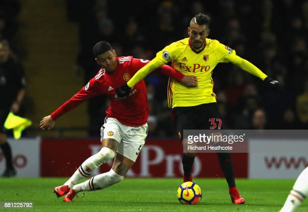 Marcos Rojo of Manchester United challenges Roberto Pereyra of Watford on his way to conceding a penalty during the Premier League match between...