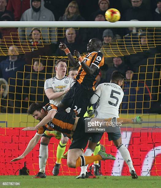 Marcos Rojo of Manchester United fouls Harry McGuire of Hull City to give away a penalty during the EFL Cup SemiFinal second leg match between Hull...
