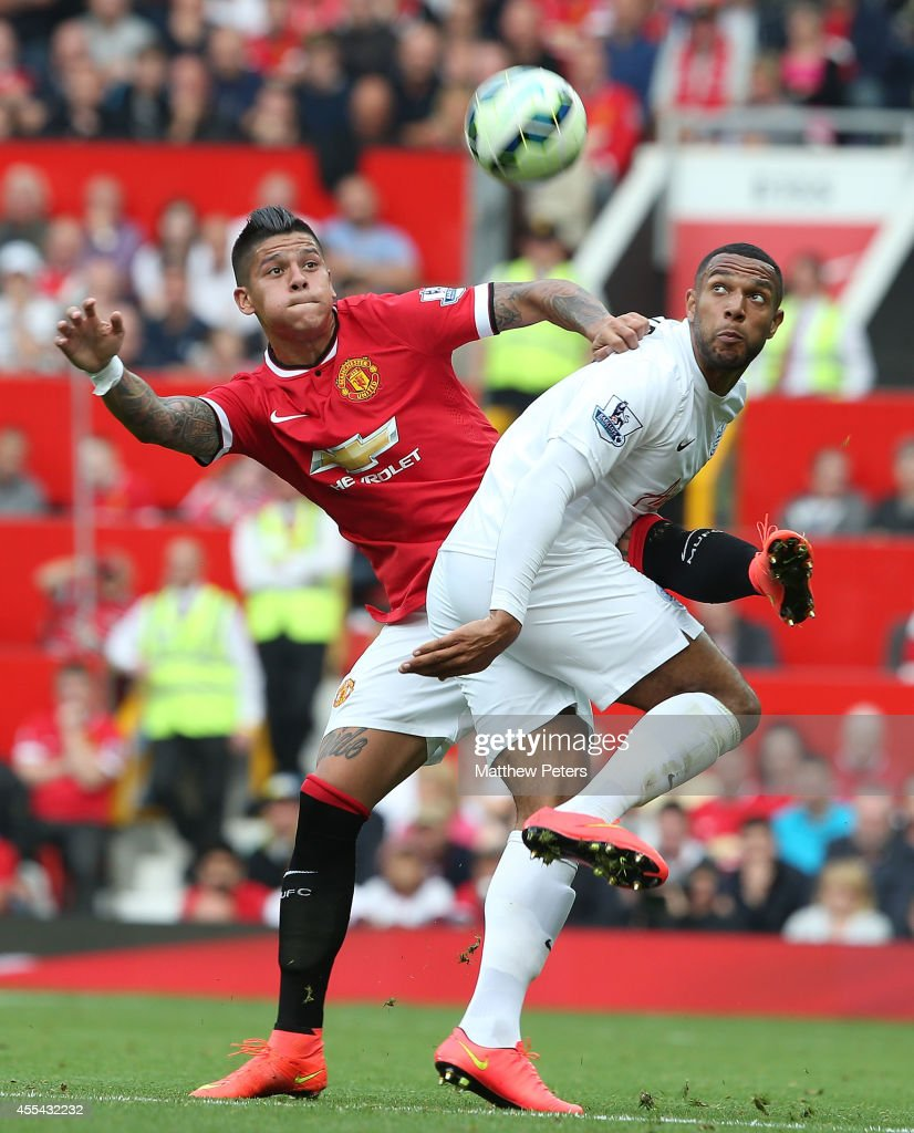 Marcos Rojo of Manchester United in action with David Hoilett of Queens Park Rangers during the Barclays Premier League match between Manchester United and Queens Park Rangers at Old Trafford on September 14, 2014 in Manchester, England.