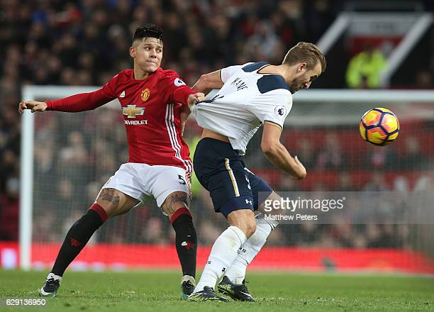 Marcos Rojo of Manchester United in action with Harry Kane of Tottenham Hotspur during the Premier League match between Manchester United and...