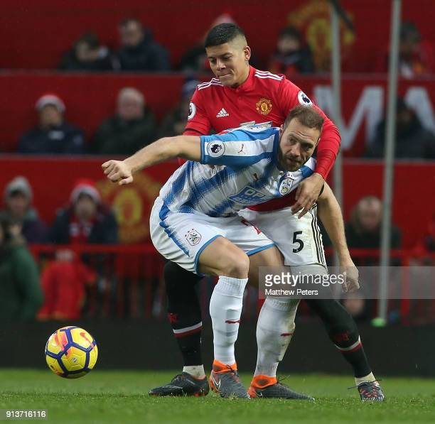 Marcos Rojo of Manchester United in action with Laurent Depoitre of Huddersfield Town during the Premier League match between Manchester United and...