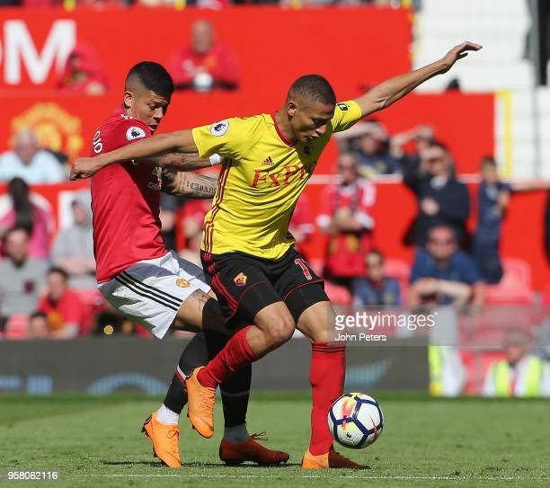 Marcos Rojo of Manchester United in action with Richarlison of Watford during the Premier League match between Manchester United and Watford at Old...