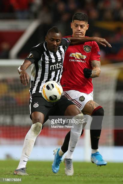 Marcos Rojo of Manchester United in action with Umar Sadiq of Partizan Belgrade during the UEFA Europa League group L match between Manchester United...