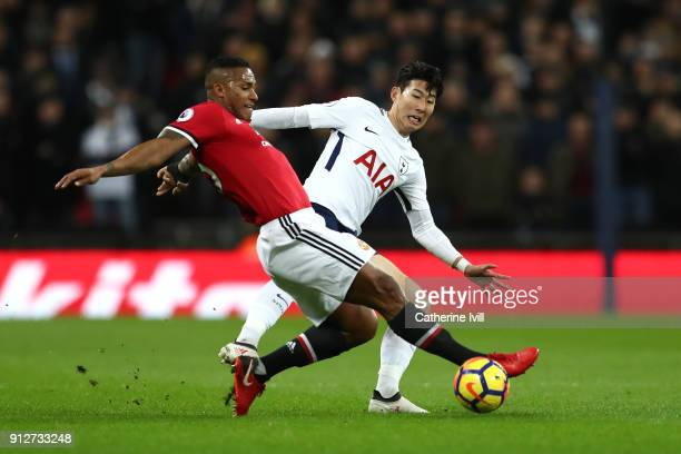 Marcos Rojo of Manchester United is challenged by HeungMin Son of Tottenham Hotspur during the Premier League match between Tottenham Hotspur and...