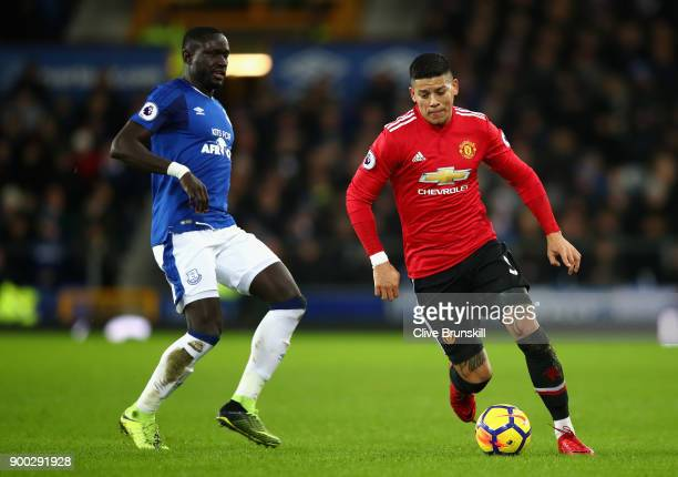 Marcos Rojo of Manchester United is chased by Oumar Niasse of Everton during the Premier League match between Everton and Manchester United at...