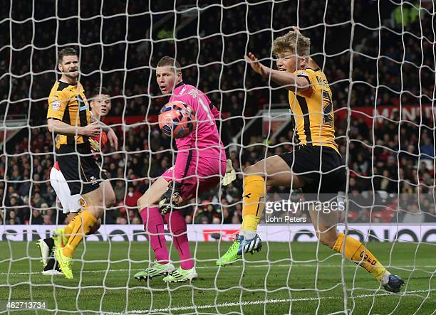 Marcos Rojo of Manchester United scores their second goal during the FA Cup Fourth Round replay between Manchester United and Cambridge United at Old...
