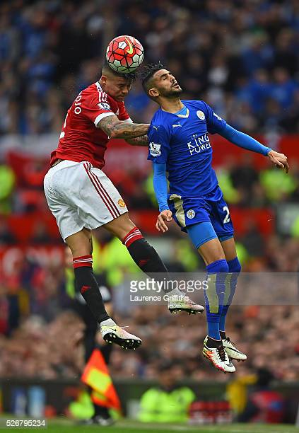 Marcos Rojo of Manchester United wins a header with Riyad Mahrez of Leicester City during the Barclays Premier League match between Manchester United...