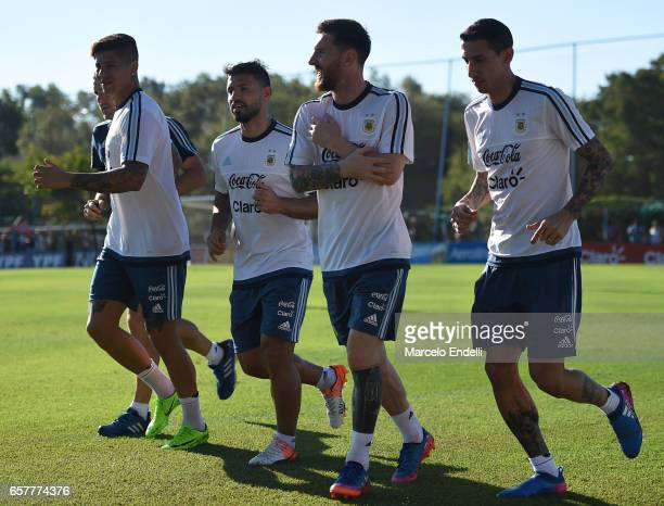 Marcos Rojo Sergio Aguero Lionel Messi and Angel Di Maria run during a training session at Argentine Football Association 'Julio Humberto Grondona'...