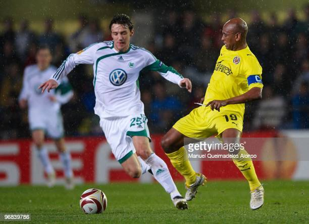 Marcos Senna of Villarreal competes for the ball with Christian Gentner of Wolfsburg during the UEFA Europa League football match between Villarreal...