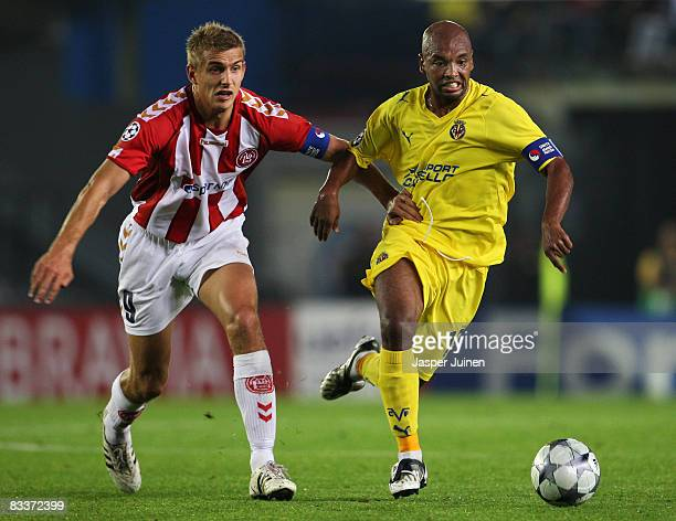 Marcos Senna of Villarreal duels for the ball with Thomas Augustinussen of Aalborg during the UEFA Champions League Group E match between Villarreal...