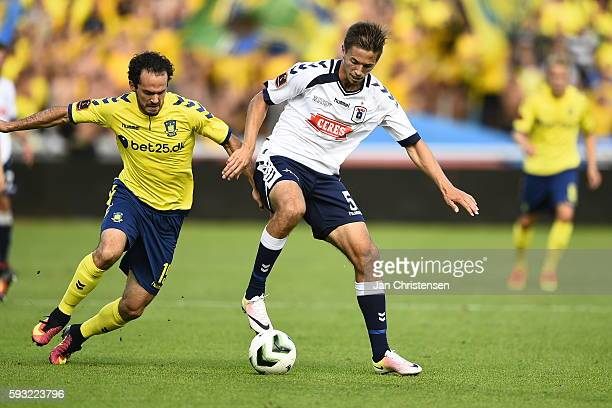 Marcos Urena of Brondby IF and Alexander Juel Andersen of AGF Arhus compete for the ball during the Danish Alka Superliga match between AGF Arhus and...