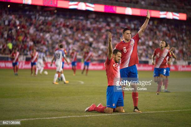 Marcos Urena of Costa Rica is congratulated on scoring by team mate Bryan Oviedo of Costa Rica during the United States Vs Costa Rica CONCACAF...