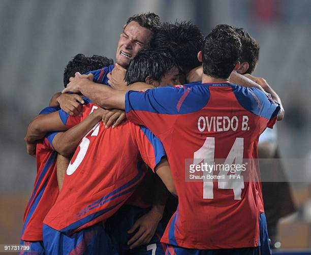 Marcos Urena of Costa Rica is mobbed by team-mates after scoring the winning goal during the FIFA U20 World Cup Quarter Final match between United...