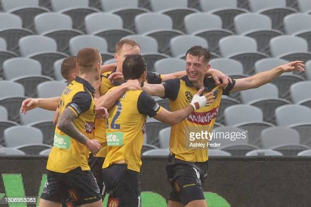 Marcos Urena of the Mariners celebrates his goal with team mates during the A-League match between the Central Coast Mariners and the Perth Glory at...