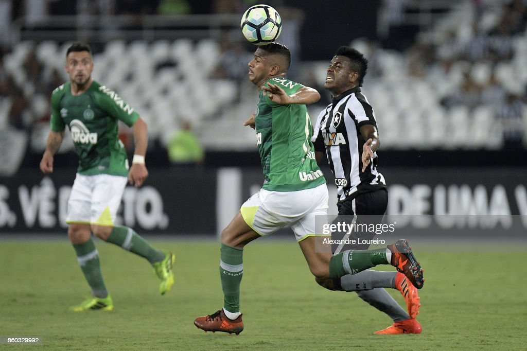 Marcos Vinicius (R) of Botafogo battles for the ball with Elicarlos(L) of Chapecoense during the match between Botafogo and Chapecoense as part of Brasileirao Series A 2017 at Engenhao Stadium on October 11, 2017 in Rio de Janeiro, Brazil.