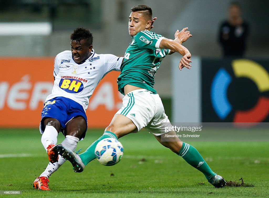 Marcos Vinicius (L) of Cruzeiro scores their first goal against Joao Pedro of Palmeiras during the match between Palmeiras and Cruzeiro for the Brazilian Series A 2015 at Allianz Parque stadium on November 21 , 2015 in Sao Paulo, Brazil.