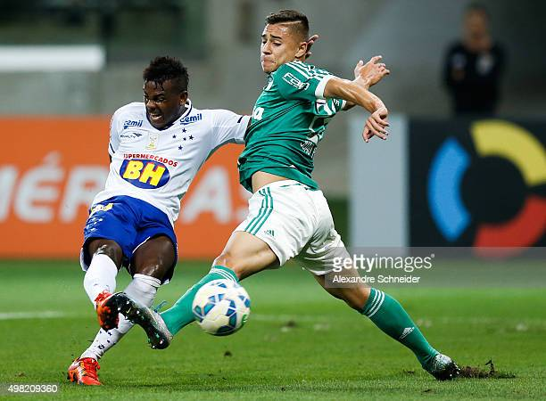 Marcos Vinicius of Cruzeiro scores their first goal against Joao Pedro of Palmeiras during the match between Palmeiras and Cruzeiro for the Brazilian...