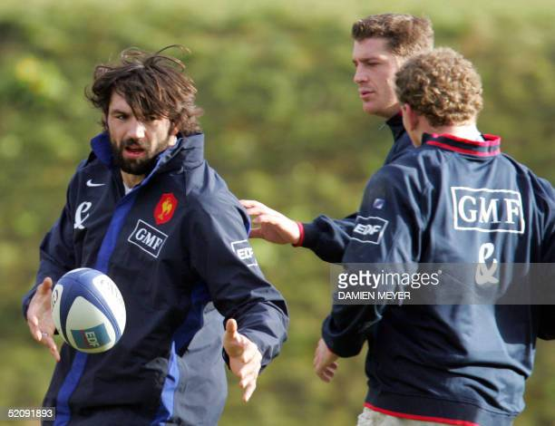 French flancker Sebastien Chabal practices with teammates lock Jerome Thion and Pieter De Villiers during a training session at the Rugby Union...