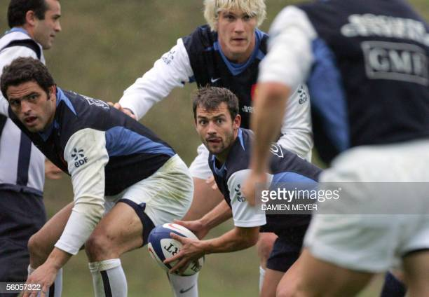 French national rugby team scrumhalf JeanBaptiste Elissalde practices 02 November 2005 with his teammates Thomas Lievremont and flanker Remy Martin...
