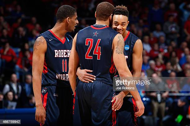 Marcquise Reed celebrates with Rodney Pryor and Aaron Tate of the Robert Morris Colonials against the North Florida Ospreys during the first round of...