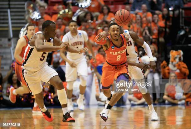 Marcquise Reed of the Clemson Tigers reaches to control the ball against Mustapha Heron of the Auburn Tigers in the first half during the second...