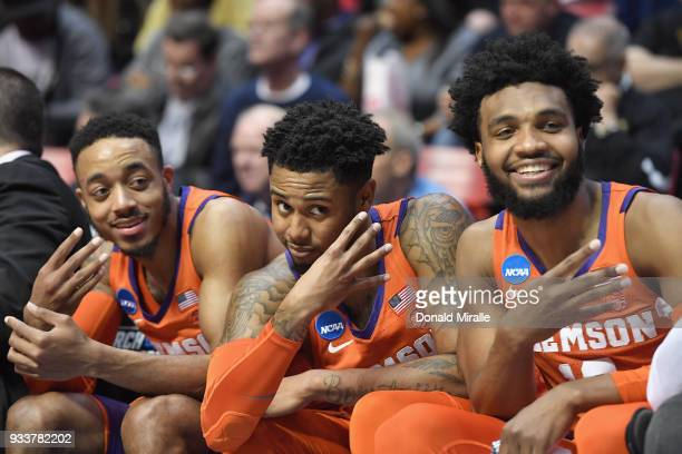 Marcquise Reed Shelton Mitchell and Gabe DeVoe of the Clemson Tigers celebrate on the bench as they take on the Auburn Tigers in the second half...