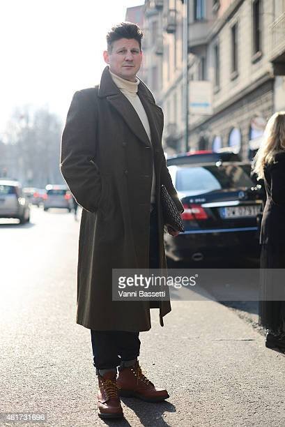 Marcus Agermann Ross poses wearing a vintage coat and Redwings shoes during day 2 of Milan Menswear Fashion Week Fall/Winter 2015/2016 on January 18...