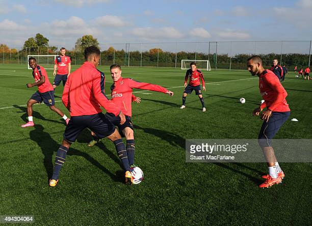 Marcus AgyeiTabi and Ben Sheaf of Arsenal during a training session at London Colney on October 26 2015 in St Albans England