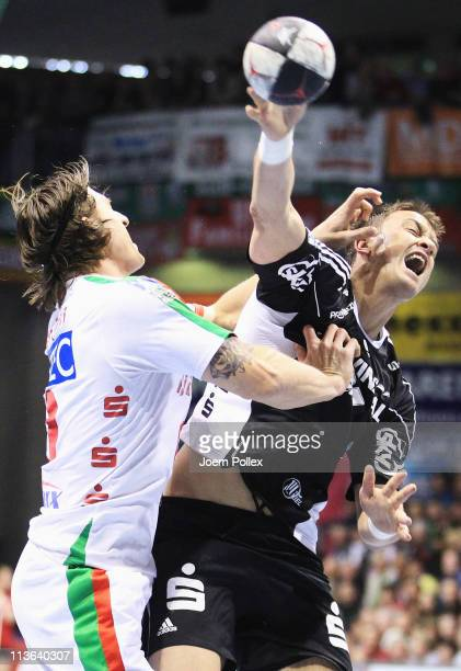 Marcus Ahlm of Kiel is challenged by Fabian van Olphen of Magdeburg during the Toyota Handball Bundesliga match between SC Magdeburg and THW Kiel at...