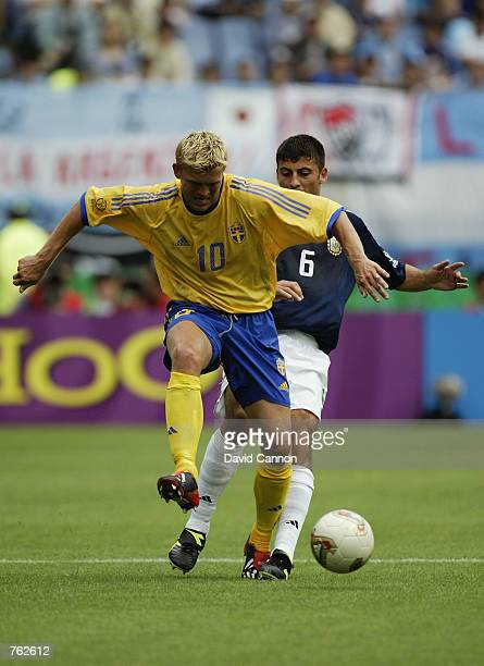 Marcus Allback of Sweden shields the ball from Walter Samuel of Argentina during the FIFA World Cup Finals 2002 Group F match played at the Miyagi...