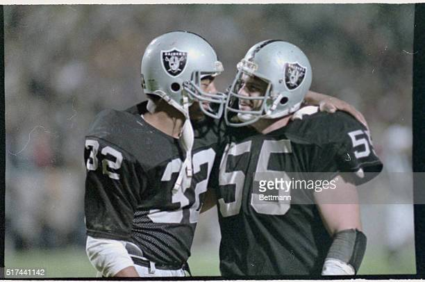 Marcus Allen #32 for the Los Angeles Raiders puts an arm around a teammate after they won Super Bowl XVIII by defeating the Washington Redskins