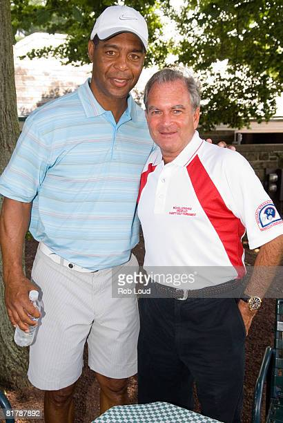 Marcus Allen and attorney Marc Dreier pose at the 2008 Michael Strahan/Dreier LLP Charity Golf Tournament at Century Country Club on June 30, 2008 in...