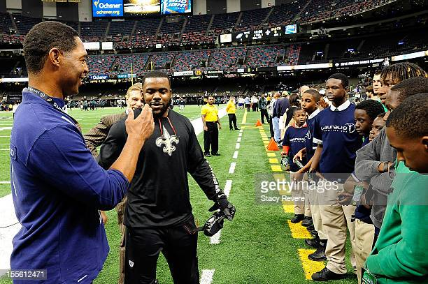 Marcus Allen greets New Orleans Saints running back Mark Ingram at the MercedesBenz Superdome for the Laureus MercedesBenz New Orleans launch on...