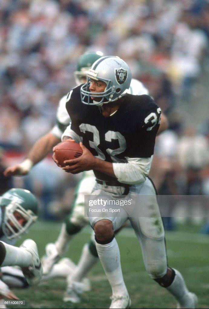 Marcus Allen of the Los Angeles Raiders carries the ball against the New York Jets during the AFC Divisional Playoff game January 15 1983 at the Los...