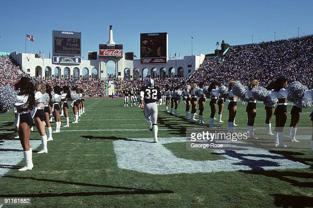 Marcus Allen of the Los Angeles Raiders is introduced to the crowd prior to the game against the Denver Broncos at the Los Angeles Memorial Coliseum...