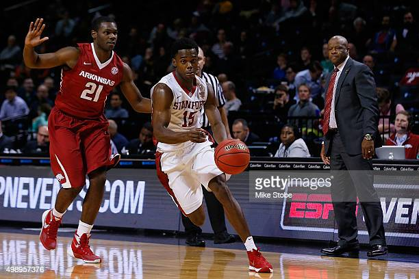 Marcus Allen of the Stanford Cardinal drives against Manuale Watkins of the Arkansas Razorbacks at Barclays Center on November 27 2015 in Brooklyn...