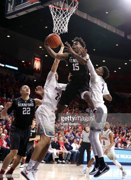 Marcus Allen of the Stanford Cardinal shoots between Chance Comanche of the Arizona Wildcats and Kobi Simmons during the first half of the college...